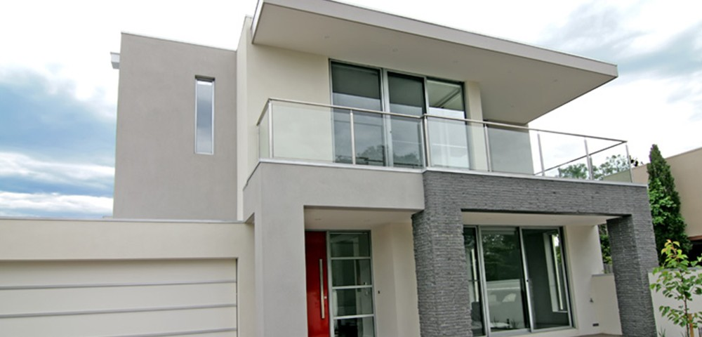 house with sliding doors and red aluminium front door