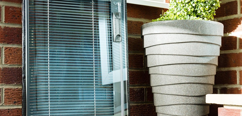unfitted integral blinds next to a plant