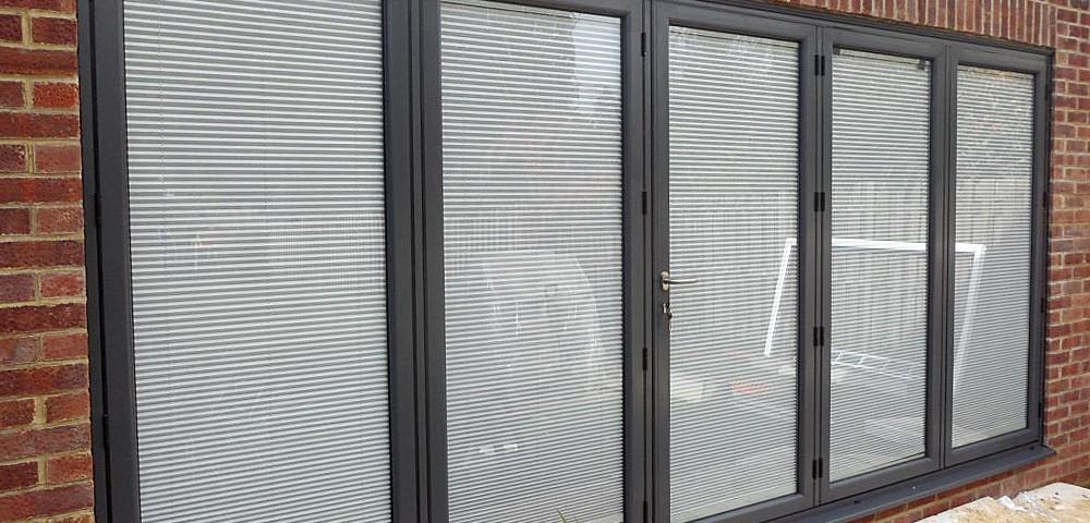 integral blinds viewed in a four pane bi-fold door