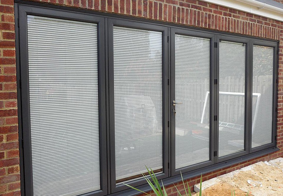 integral blinds viewed in a four pane bi-fold door