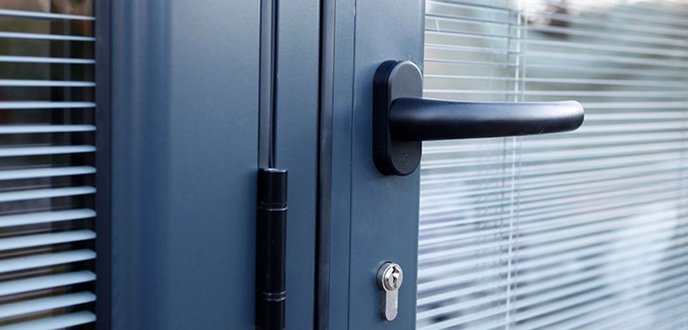integral blinds in a grey bi-fold door
