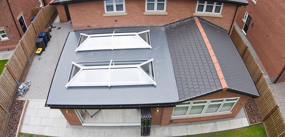 two roof lanterns on a flat roof