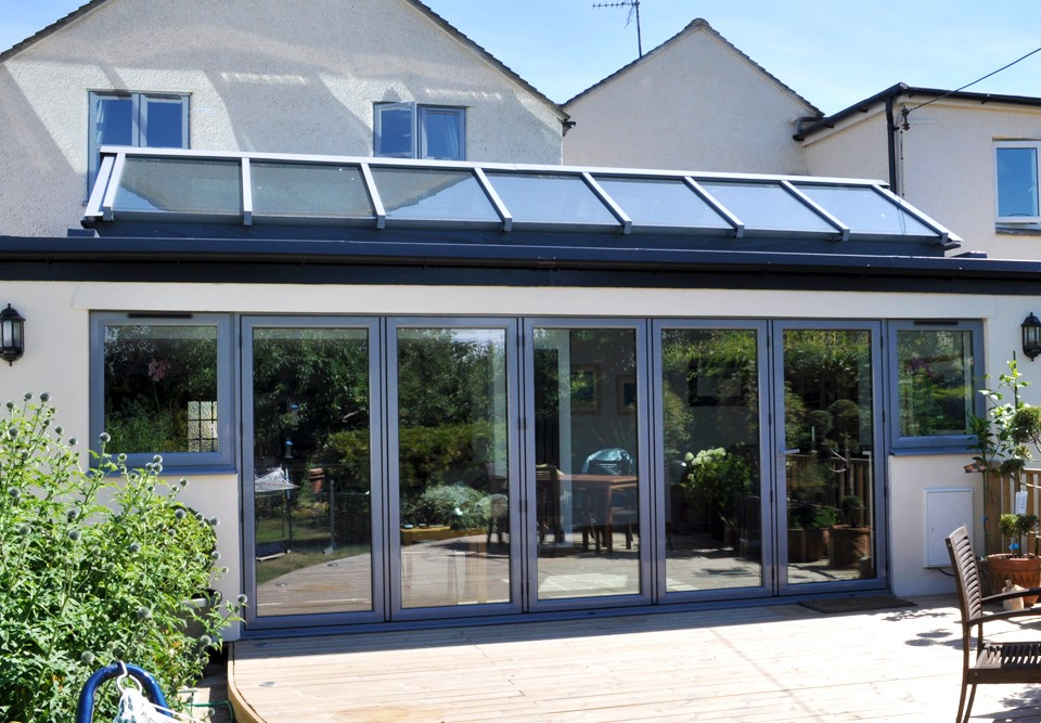5 pane Aluminium Bi-fold with connecting lean to glass roof