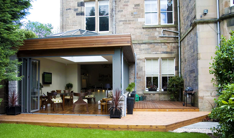 Modern contemporary orangery to the rear of a house with a set of bi-fold doors and roof lantern