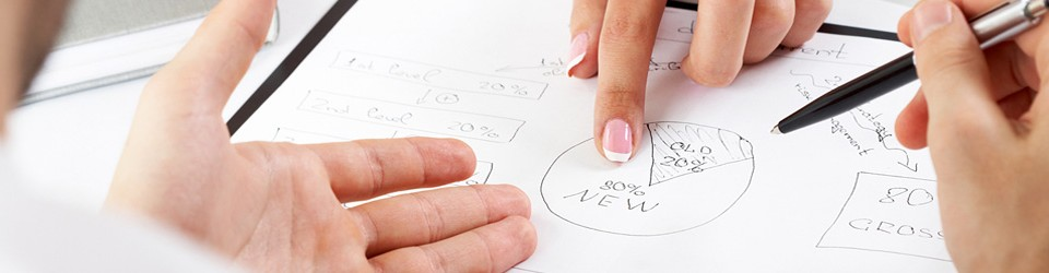 hands pointing to diagrams on paper