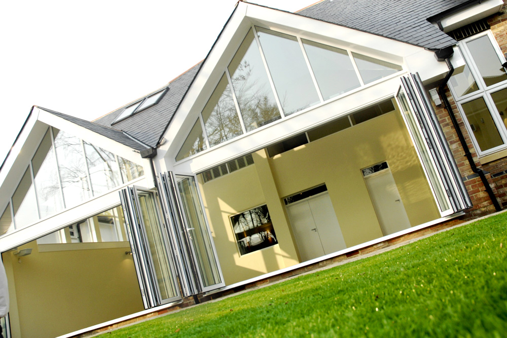 2 large white smarts visofold aluminium bi-fold doors with large gable end windows