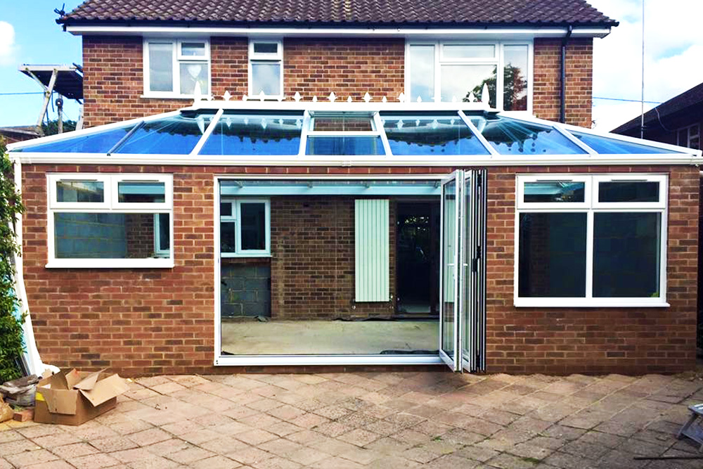 bi-fold door and roof lantern installed into an unfinished extention