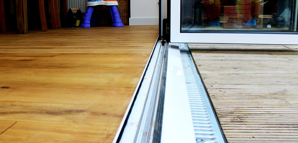 internal level threshold for a bi-fold door with a white cill with a gully drain to the front